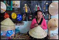 Woman in hat-making workshop. Hue, Vietnam (color)