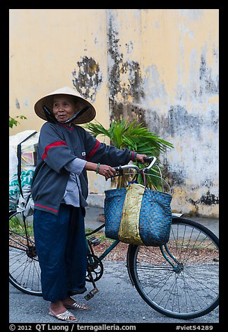 Elderly woman with bicycle, Thanh Toan. Hue, Vietnam (color)
