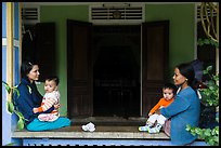 Mothers and infants on porch, Thanh Toan. Hue, Vietnam (color)
