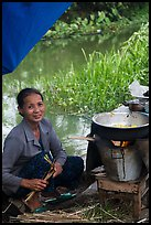 Woman cooking canalside, Thanh Toan. Hue, Vietnam ( color)