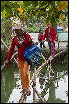 Women crossing monkey bridge, Thanh Toan. Hue, Vietnam (color)
