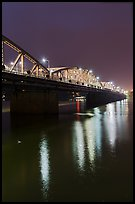 Trang Tien Bridge lights reflected in Perfume River. Hue, Vietnam (color)