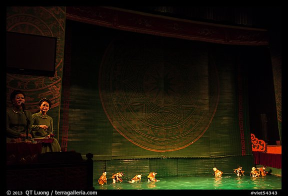 Musicians and water puppets during performance, Thang Long Theatre. Hanoi, Vietnam (color)