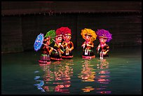 Water puppets (5 characters with umbrellas), Thang Long Theatre. Hanoi, Vietnam ( color)