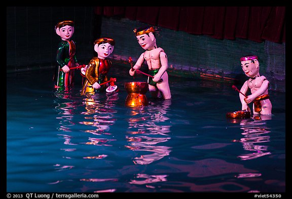 Water puppets (4 characters with musical instruments), Thang Long Theatre. Hanoi, Vietnam (color)
