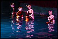 Water puppets (4 characters with musical instruments), Thang Long Theatre. Hanoi, Vietnam ( color)
