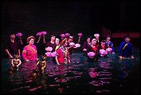Water puppet artists standing in pool after performance, Thang Long Theatre. Hanoi, Vietnam ( color)