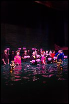 Water puppet artists receiving applause in pool after performance, Thang Long Theatre. Hanoi, Vietnam (color)