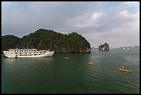 Tour boat and sea kayaks. Halong Bay, Vietnam (color)