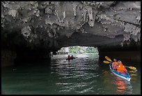 Paddling through Luon Cave tunnel. Halong Bay, Vietnam (color)