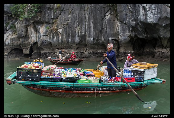 Grocer on rowboat. Halong Bay, Vietnam (color)