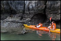 Sea kayakers approaching monkey. Halong Bay, Vietnam (color)