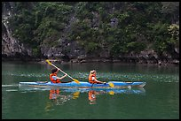 Sea kayakers on emerald waters. Halong Bay, Vietnam (color)