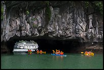 Kayaks floating through Luon Can tunnel. Halong Bay, Vietnam (color)
