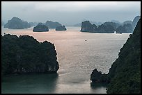 Elevated view of monolithic islands from above, evening. Halong Bay, Vietnam ( color)