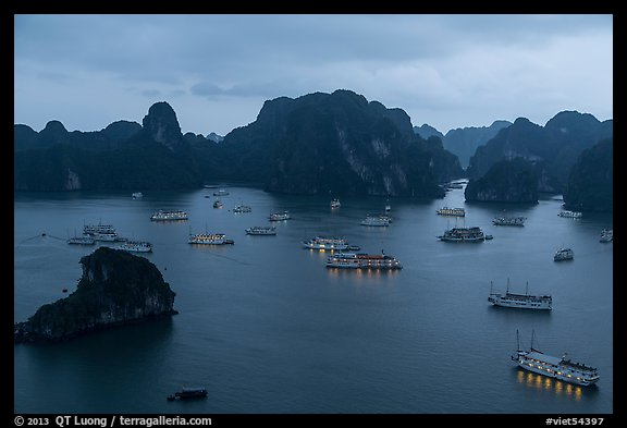Moored boats and islands from above at dusk. Halong Bay, Vietnam (color)