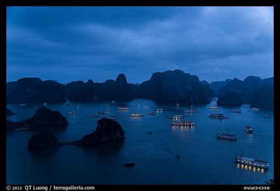Tour boats lights and islands from above at night. Halong Bay, Vietnam (color)