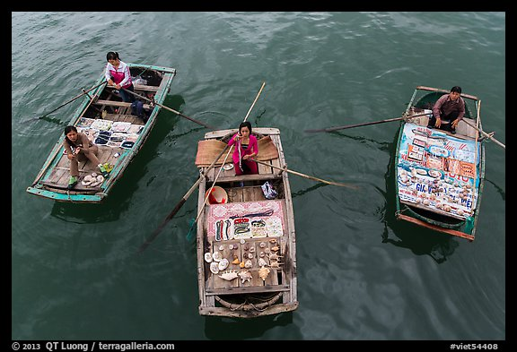 Women selling sea shells and perls from row boats. Halong Bay, Vietnam (color)