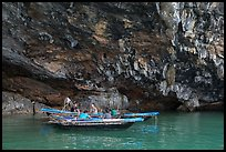 Fishermen anchor in cave for breakfast. Halong Bay, Vietnam (color)