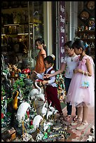 Children checkout ceramic store. Bat Trang, Vietnam (color)