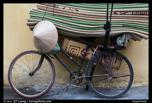 Bicycle loaded with mats, old quarter. Hanoi, Vietnam (color)