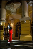 Woman in evening gown entering opera house. Hanoi, Vietnam (color)