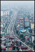 Expressway and buildings in mist seen from above. Hanoi, Vietnam (color)