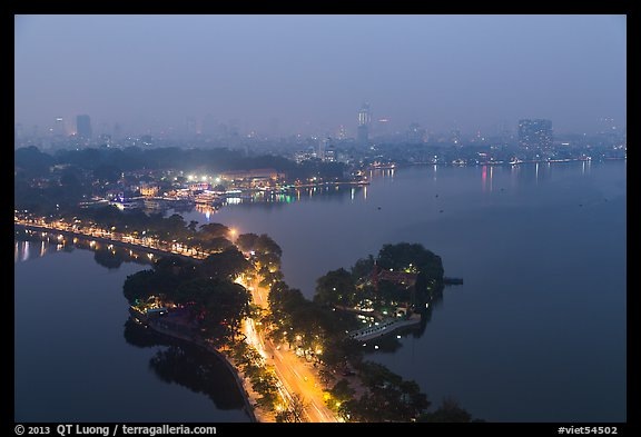 West Lake and city skyline from above by night. Hanoi, Vietnam (color)