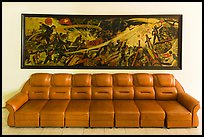 Propaganda painting and couch, military museum. Hanoi, Vietnam (color)