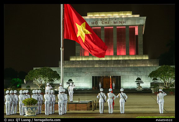 Lowering of flag in front of Ho Chi Minh Mausoleum at night. Hanoi, Vietnam (color)