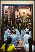 Women worshipping in Phung Son Pagoda, district 11. Ho Chi Minh City, Vietnam (color)