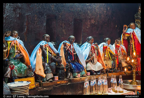 Ceramic figures of 12 women, each examplifying a human characteristic, Jade Emperor Pagoda, district 3. Ho Chi Minh City, Vietnam (color)