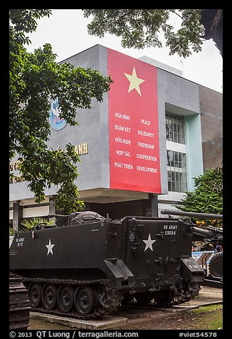 Tanks and signs extolling peace, War Remnants Museum, district 3. Ho Chi Minh City, Vietnam (color)