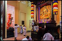 Women worshipping, An Quang Pagoda, district 10. Ho Chi Minh City, Vietnam (color)
