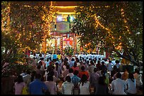 Worshippers at Quoc Tu Pagoda by night, district 10. Ho Chi Minh City, Vietnam ( color)