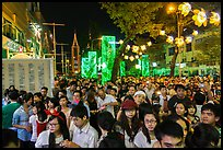 Street filled with crowds on Christmas eve. Ho Chi Minh City, Vietnam (color)