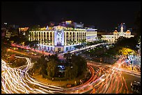 Traffic circle with light trails, Rex Hotel and City Hall. Ho Chi Minh City, Vietnam