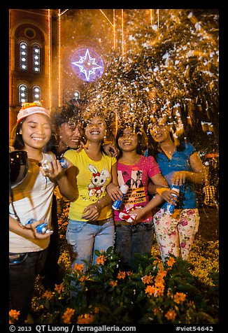 Young Revellers in front of Notre Dame Cathedral on Christmas Eve. Ho Chi Minh City, Vietnam (color)
