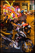 Man with coiffe of balloons, Christmas Eve. Ho Chi Minh City, Vietnam (color)