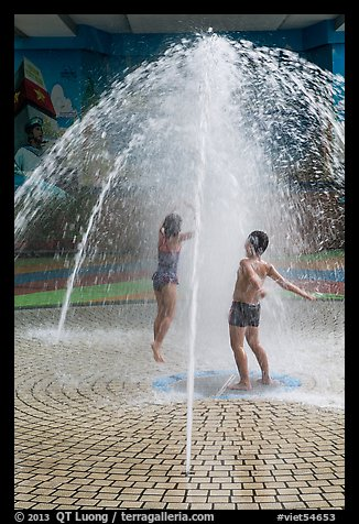 Children in fountain, Dam Sen Water Park, district 11. Ho Chi Minh City, Vietnam (color)