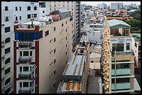 Rooftop view of skinny hotel buildings. Ho Chi Minh City, Vietnam ( color)
