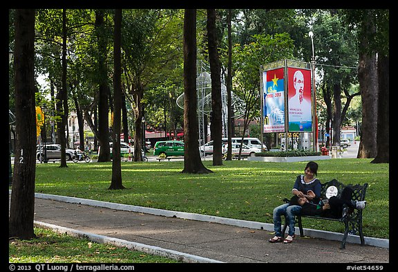 Relaxing on a public bench in April 30 Park. Ho Chi Minh City, Vietnam (color)
