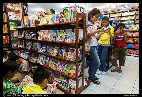 Bookstore shelves and children reading. Ho Chi Minh City, Vietnam (color)