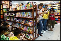 Bookstore shelves and children reading. Ho Chi Minh City, Vietnam ( color)