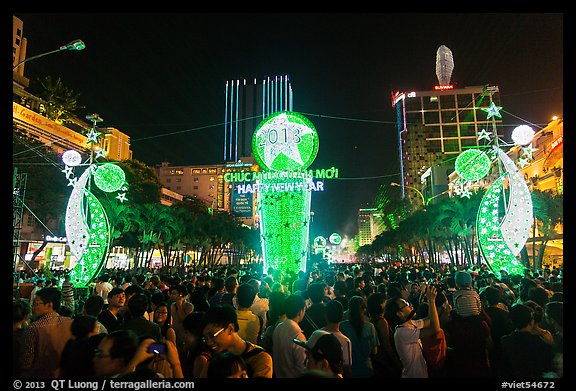 Crowds on Nguyen Hue boulevard on New Year eve. Ho Chi Minh City, Vietnam (color)