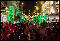 Packed street at night, New Year eve. Ho Chi Minh City, Vietnam (color)