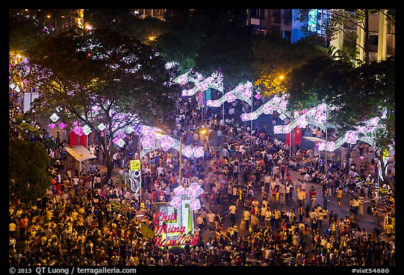 Le Loi boulevard with decorations and crowds from above. Ho Chi Minh City, Vietnam (color)
