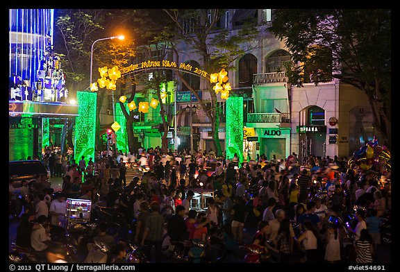 Crowds on street at night, New Year eve. Ho Chi Minh City, Vietnam (color)