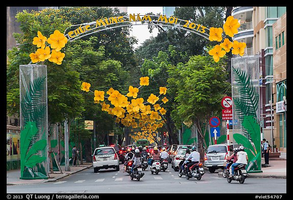 Street with holiday decorations. Ho Chi Minh City, Vietnam (color)
