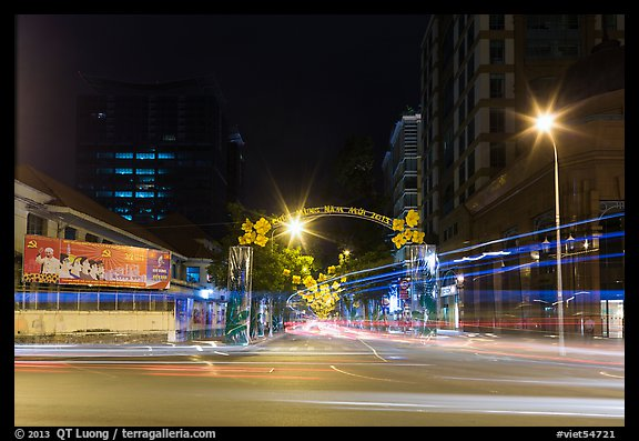 Dong Khoi street at night with light trails and decorations. Ho Chi Minh City, Vietnam (color)